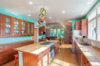 Modern home with Kitchen, Medium Hardwood Floor, Refrigerator, Range, Wood Counter, Drop In Sink, Cooktops, Microwave, Wood Cabinet, and Ceiling Lighting. New kitchen uses color in a big way Photo 6 of Massive Addition does not over-whelm