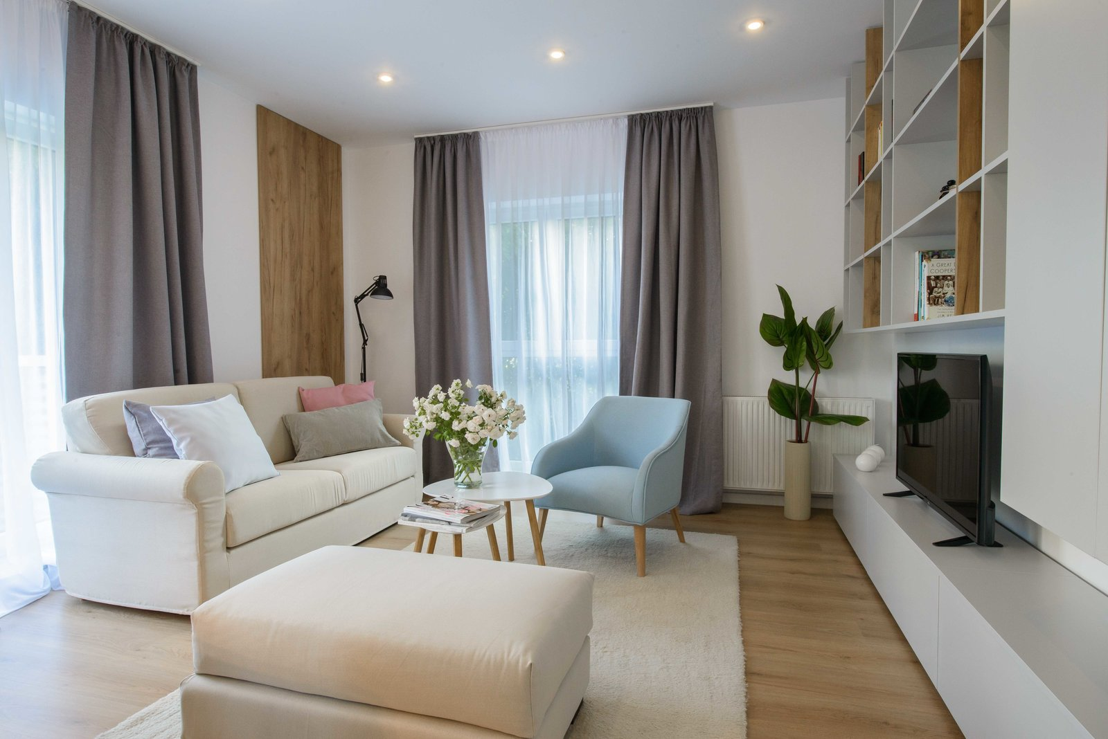 Working on a budget is no easy thing, but with the clever eye of an interior designer, every space can become a home. Having in mind that great design doesn't stand out, it only makes your living environment more pleasant, the designer has chosen soft lines, neutral colors and some small pastel accents.  Neutrals and soft pastels