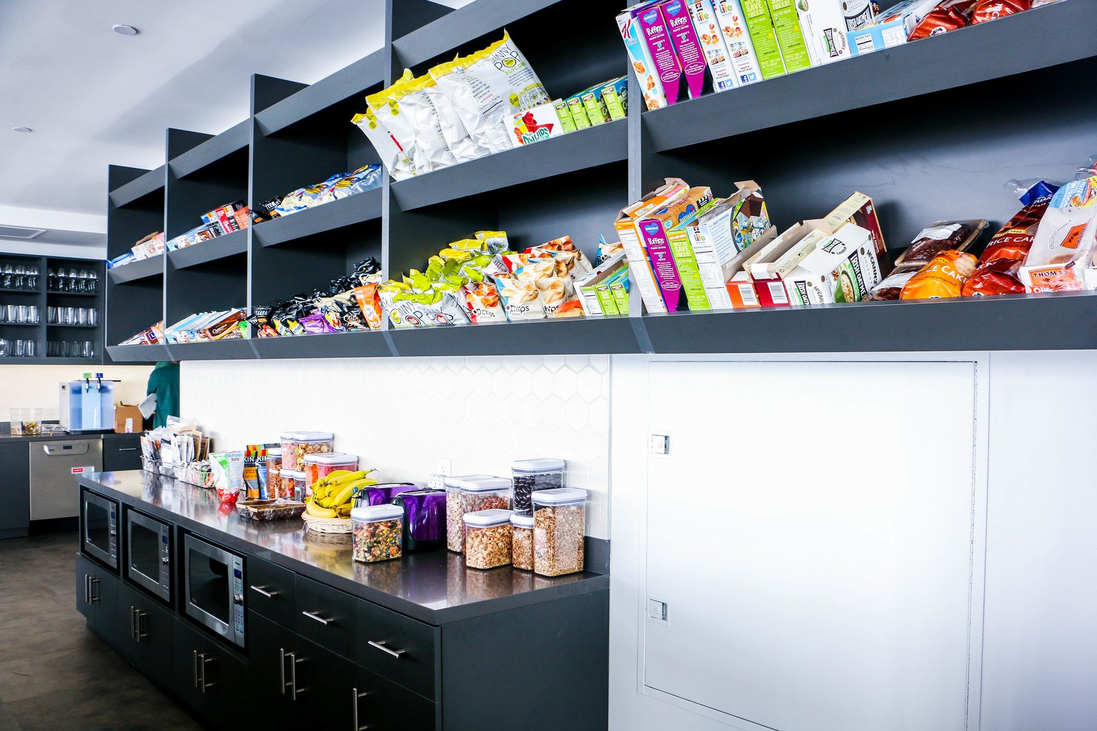 Custom kitchen stocked with a plethora of snacks!  Photo 1 of 4 in Culture by Design: Datadog HQ from Peek inside Datadog's office