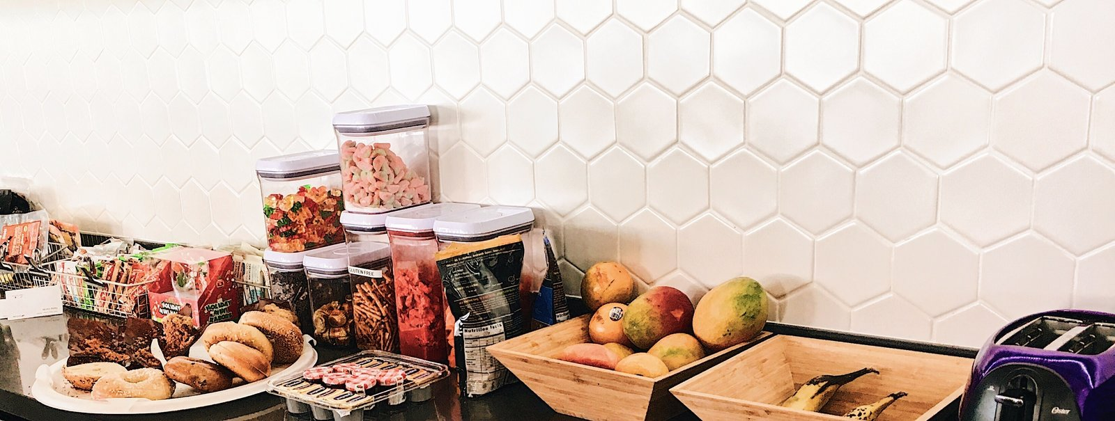 Certain pops of color throughout the space, and the honeycomb backsplash shown here, mimic the product. Nuanced touches such as these bring a smile to the face of those who are in the know.  Photo 3 of 4 in Culture by Design: Datadog HQ
