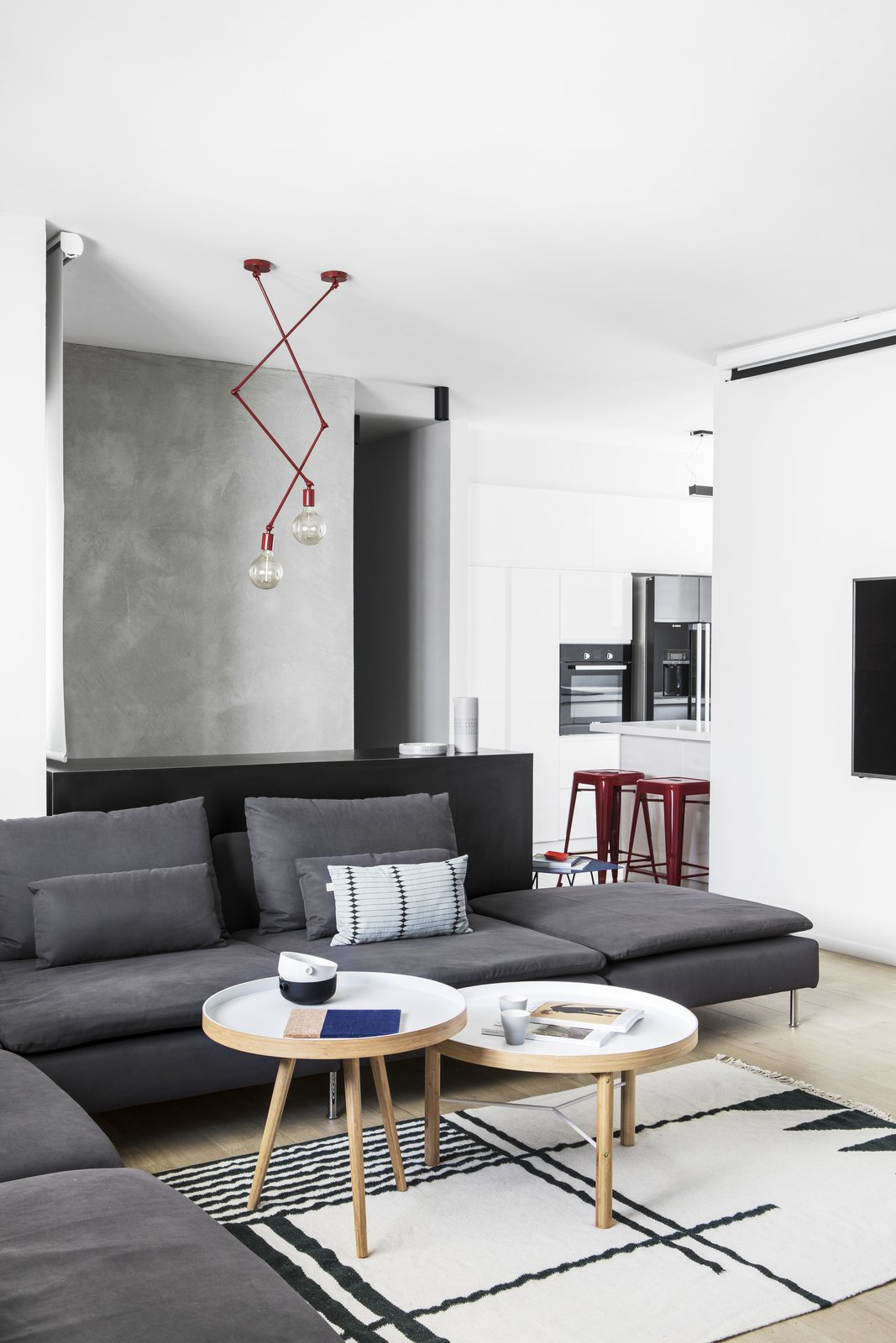 Living Room, Bench, Chair, Floor Lighting, Light Hardwood Floor, Sofa, and Ceiling Lighting Living Room  A|A Duplex by YAEL PERRY | INTERIOR DESIGNER