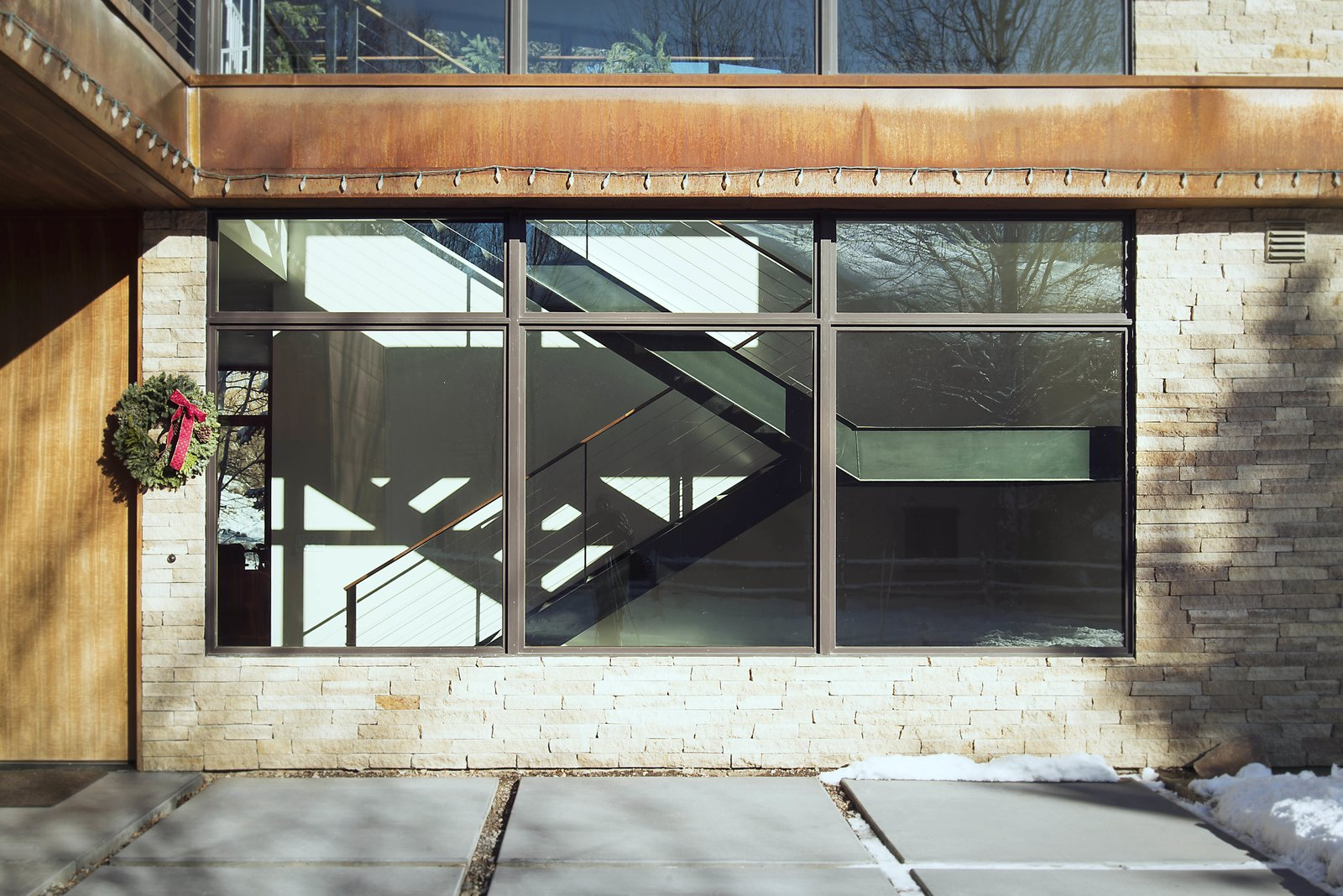 Staircase Viewed from Exterior  Lucky John Home by Imbue Design