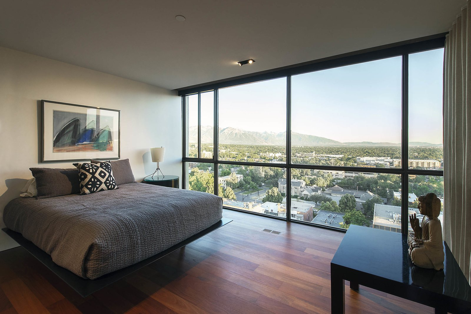 Bedroom, Night Stands, Lamps, Table Lighting, Bed, Recessed Lighting, and Medium Hardwood Floor guest bedroom - looking  to wasatch mountain range beyond  Best Photos from Governors Plaza