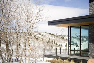 The viewing deck wraps around the home to provide views in every direction.