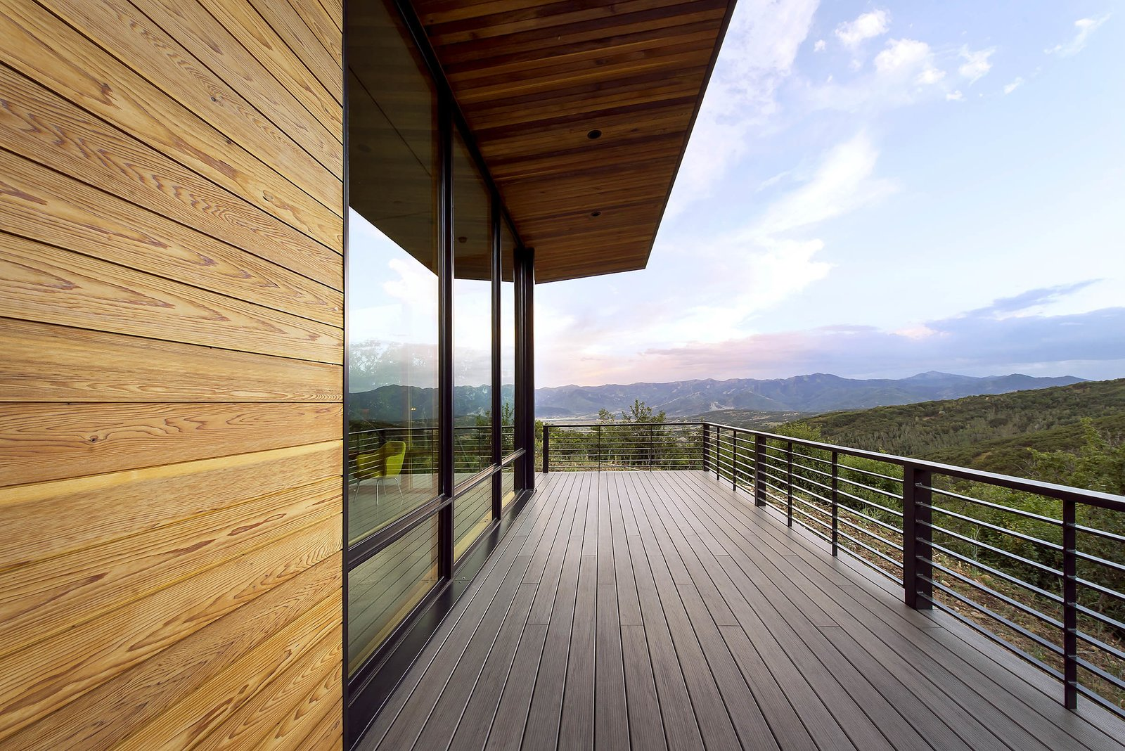 Outdoor, Back Yard, Large Patio, Porch, Deck, Decking Patio, Porch, Deck, Wire Fences, Wall, Metal Fences, Wall, and Horizontal Fences, Wall The sun has just set on this view of the Wasatch Mountain Range.  Photos from Red Hawk