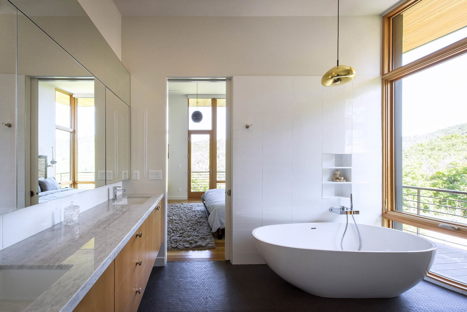 Bath, Marble, Ceramic Tile, Undermount, Freestanding, Open, Pendant, Ceramic Tile, and Subway Tile The master bathroom is flooded with light and views while maintaining privacy screened by the scrub oak preserved on lot.  Bath Ceramic Tile Subway Tile Marble Photos from Red Hawk