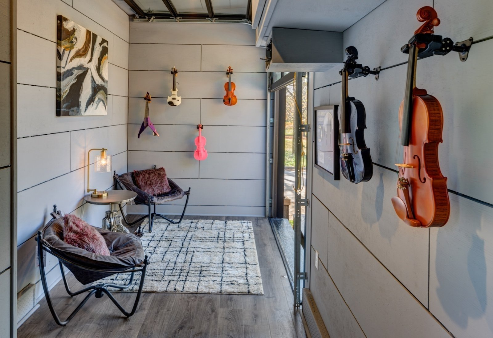 Office, Craft Room Room Type, and Chair Music Room  Soundproofed with recycled denim, marine speakers on top facing the deck for the amplified sound.  Amplified Tiny House