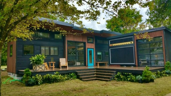 """Exterior, House Building Type, Wood Siding Material, and Metal Siding Material Exterior of """"Amplified"""" Tiny House. Exterior furniture by Ecovet Furniture. Their furniture is custom built by veterans using reclaimed material from decommissioned trailers.  Amplified Tiny House"""