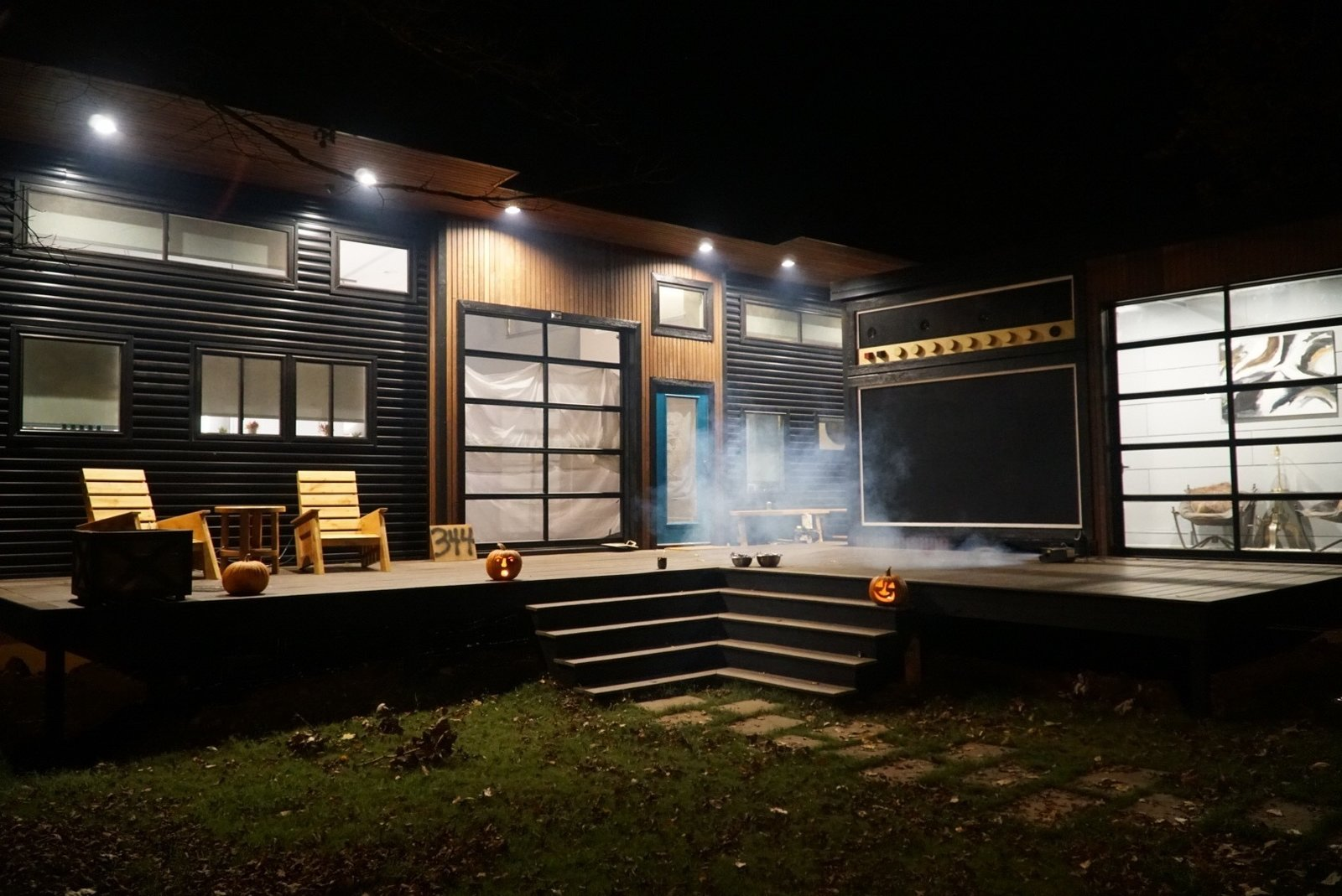 "Exterior, Metal Roof Material, Metal Siding Material, and Wood Siding Material ""Amplified"" Tiny House at Night  Amplified Tiny House"
