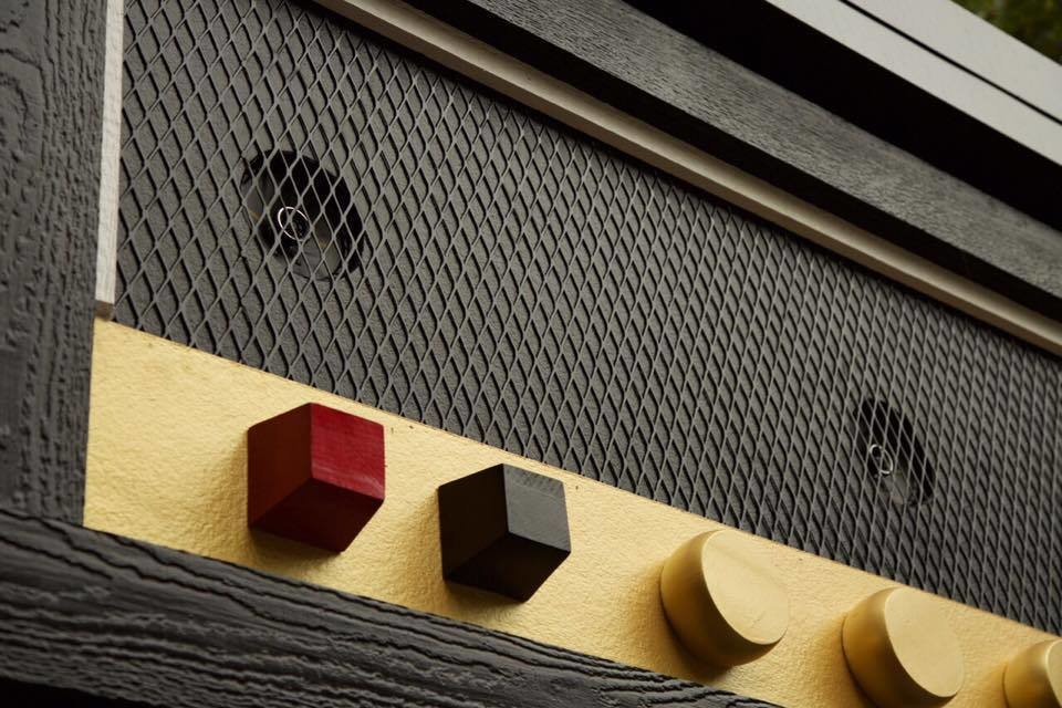 Exterior and Metal Siding Material Close-up of the amplifier with marine speakers facing the deck  Amplified Tiny House