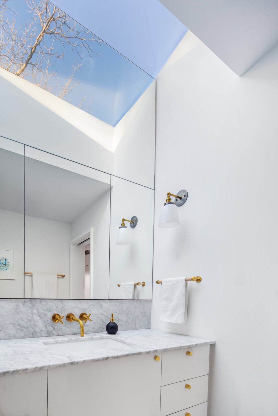 Bath, Marble, Marble, Undermount, Wall, Accent, Marble, and One Piece Master bath with reflected skylight  Best Bath Undermount Marble Photos from Ritchie Rowhouse