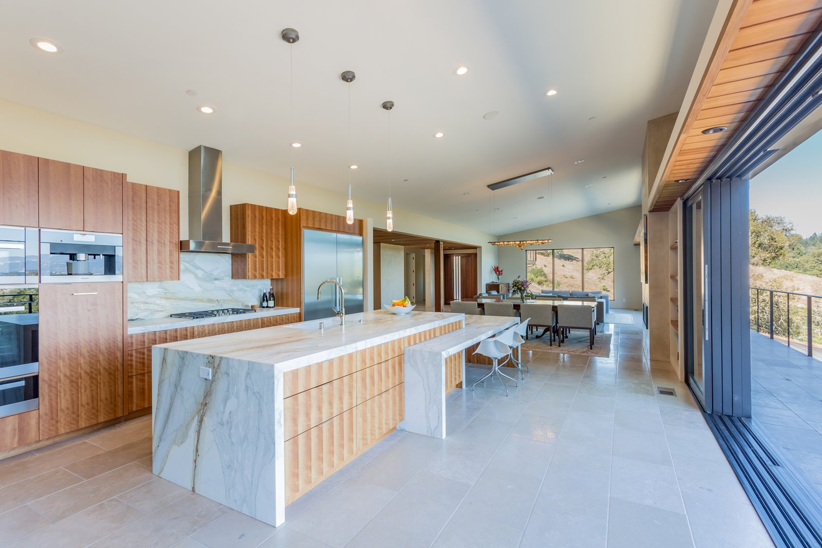 Healdsburg Home kitchen with wood cabinetry and marble finishes