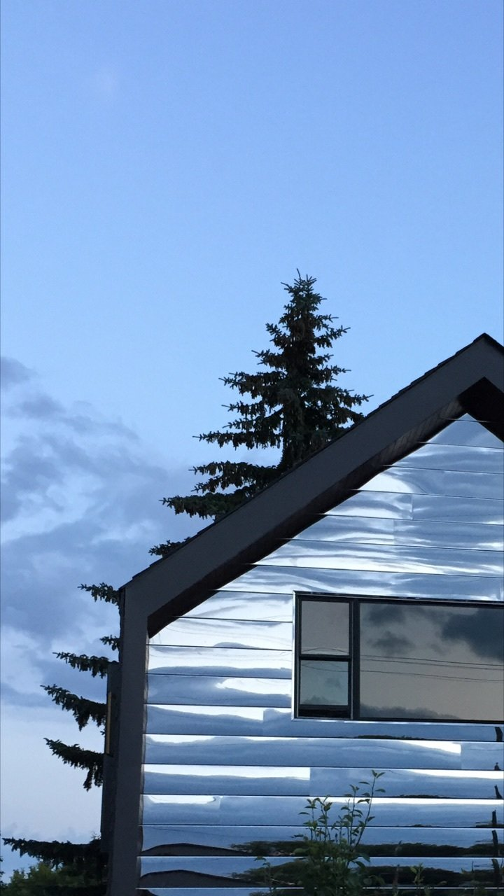 Exterior, Apartment Building Type, and Metal Siding Material South Elevation - Evening Reflection  Calder Laneway House - Edmonton