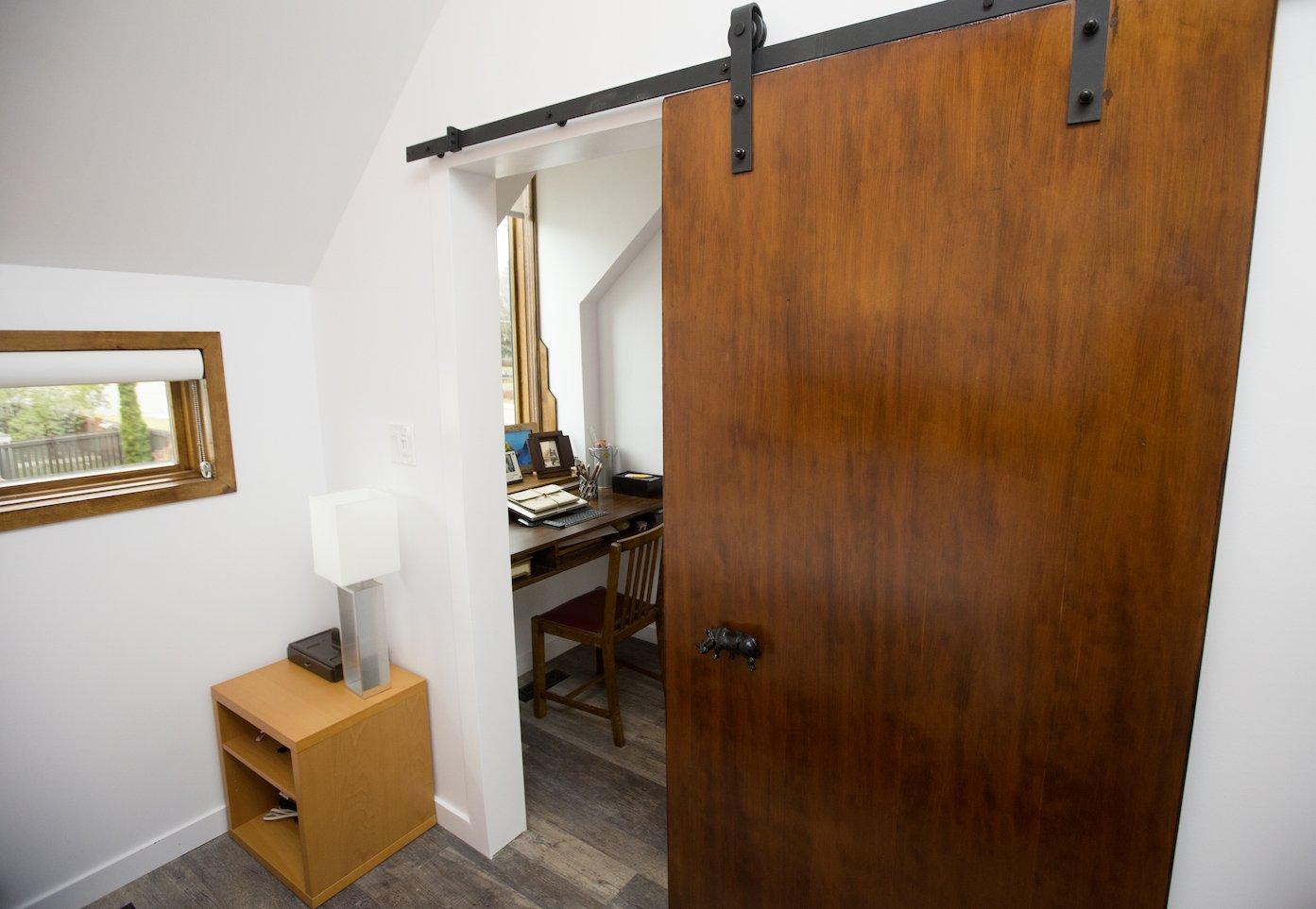 Bedroom and Vinyl Floor Calder - Interior 2 - Recycled Barn Door  Calder Laneway House - Edmonton