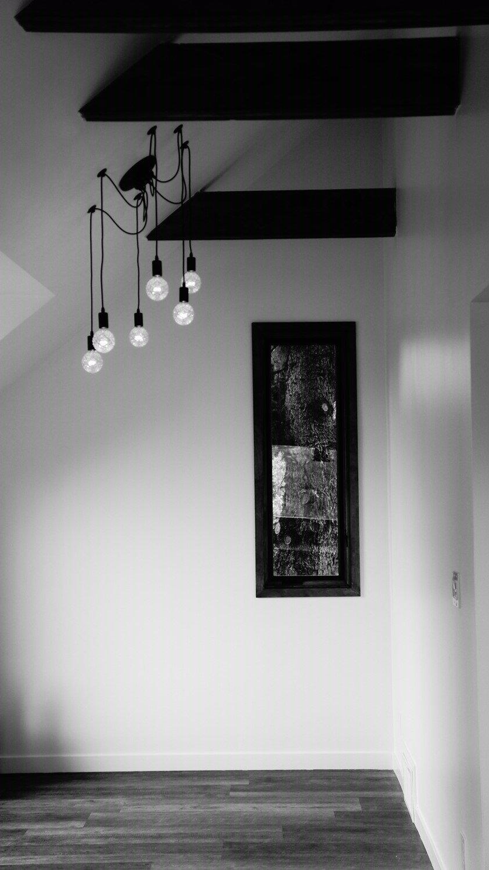 Living Room, Pendant Lighting, Accent Lighting, and Vinyl Floor Calder - Interior 8 - Tree Framed in Living Room  Calder Laneway House - Edmonton