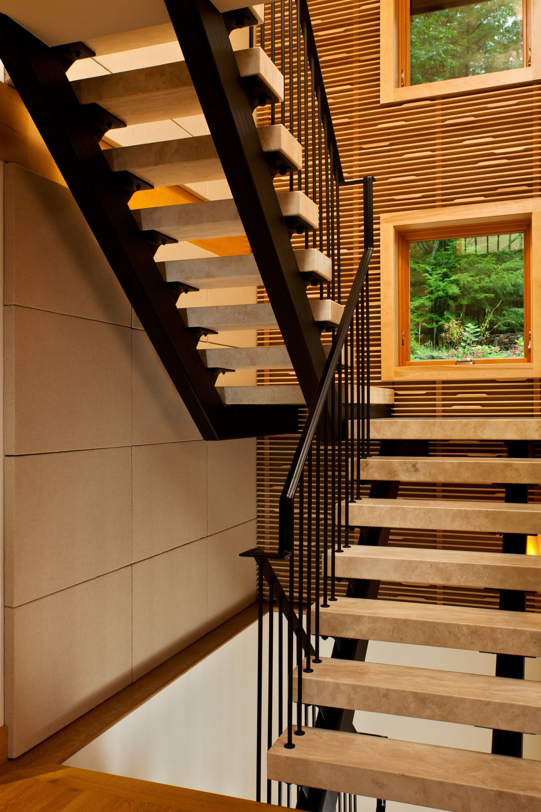 Floating travertine staircase  Fourth Lake Summer House by Phinney Design Group