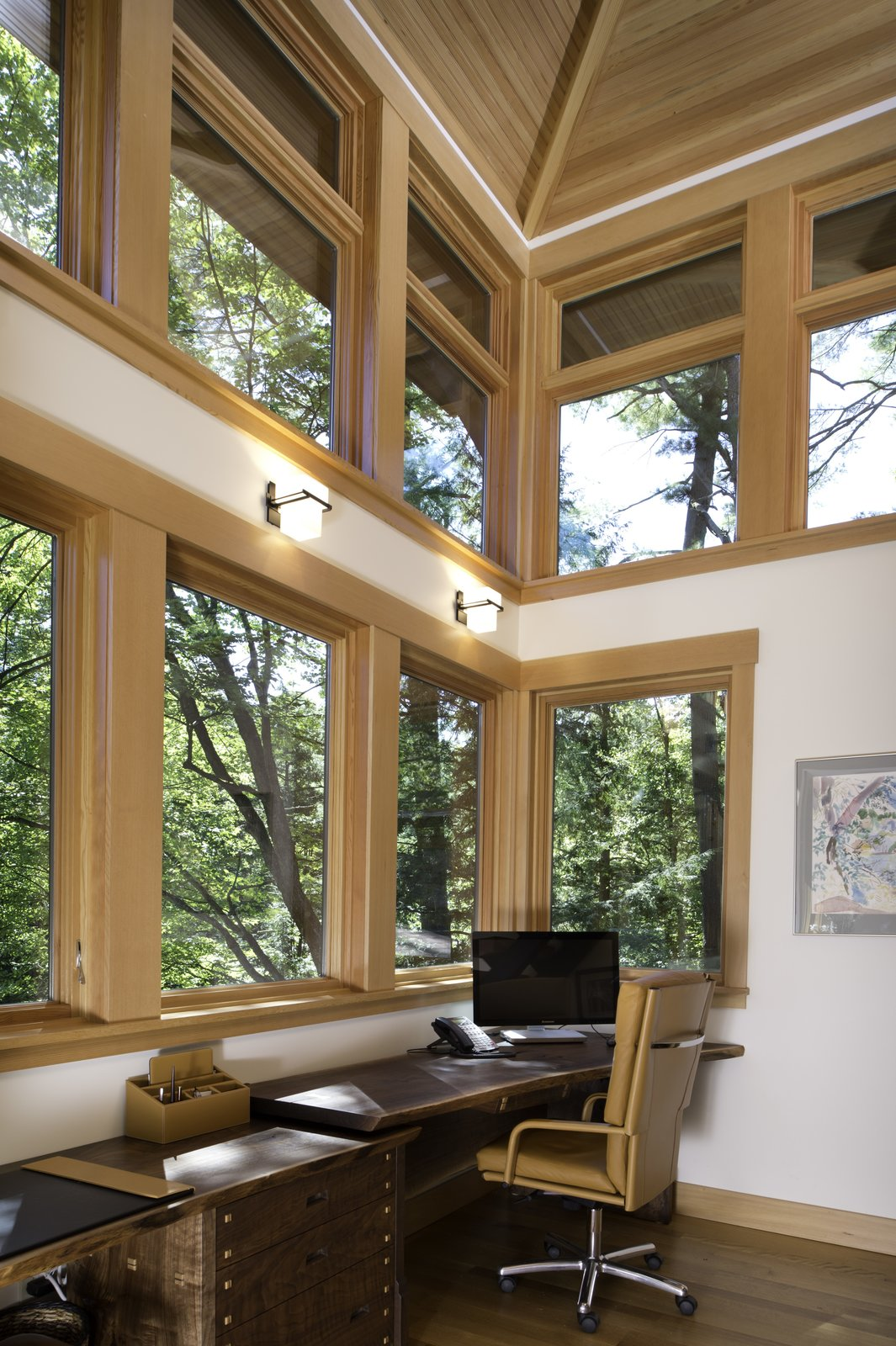First floor of two-story home office   Fourth Lake Summer House by Phinney Design Group