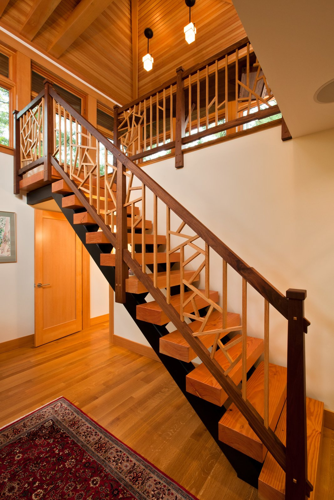 Staircase to second floor of home office, designed by local Adirondack artist  Fourth Lake Summer House by Phinney Design Group