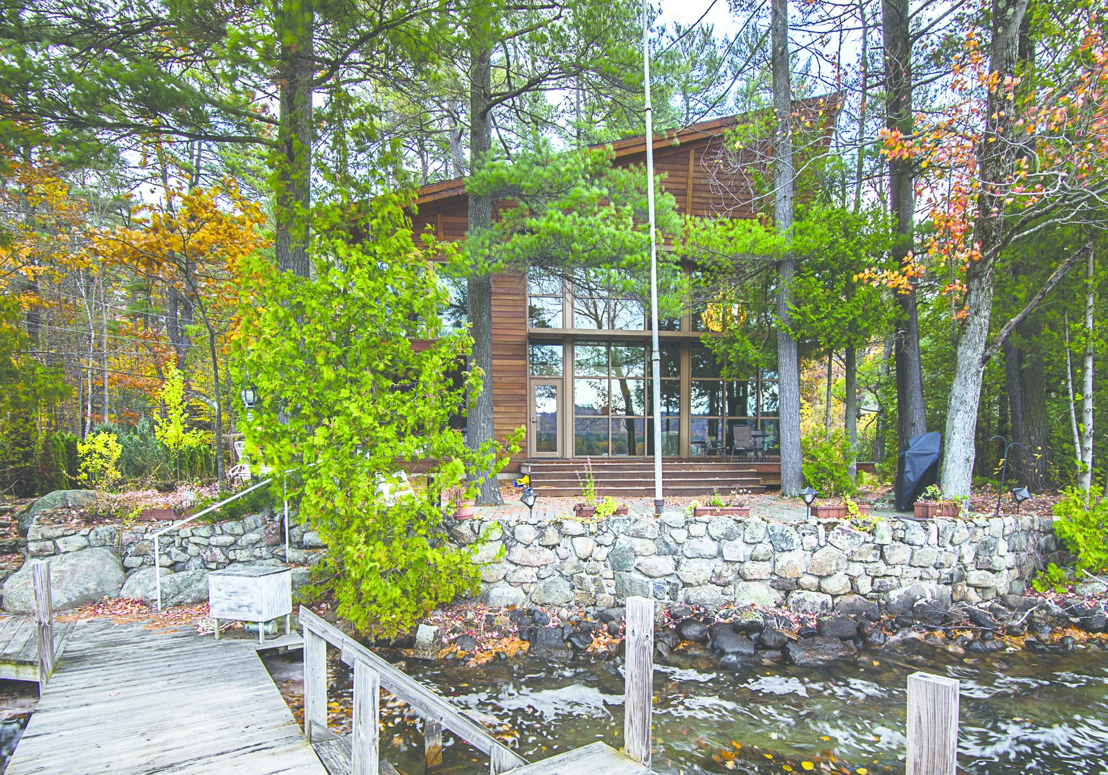 The main living space was built on an existing camp footprint. This was done to maintain the proximity to the lake as the existing camp was well beyond the required shoreline set back.  Modern Adirondack Retreat