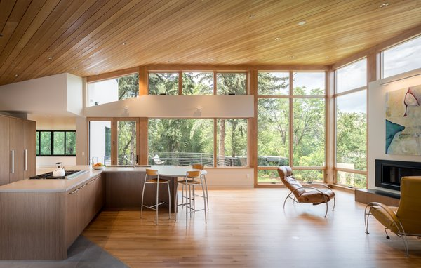 """Each layer of Gregory Creek Residence relates differently to the surrounding natural environment. """"Overall an open visual flow connects those in the home to the creek and its creatures, while offering protection via the use of cantilevers,"""" says Gettliffe Architecture."""