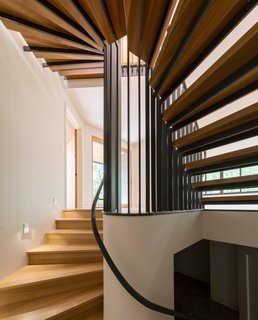 The design of Gregory Creek Residence was developed through an organic process. It evolved with ongoing client participation, was nurtured by in-studio group design sessions, and fine-tuned during a collaborative construction process. The home's staircase winds up several levels, imitating the visual flow Gettliffe Architecture sought after in the design process.