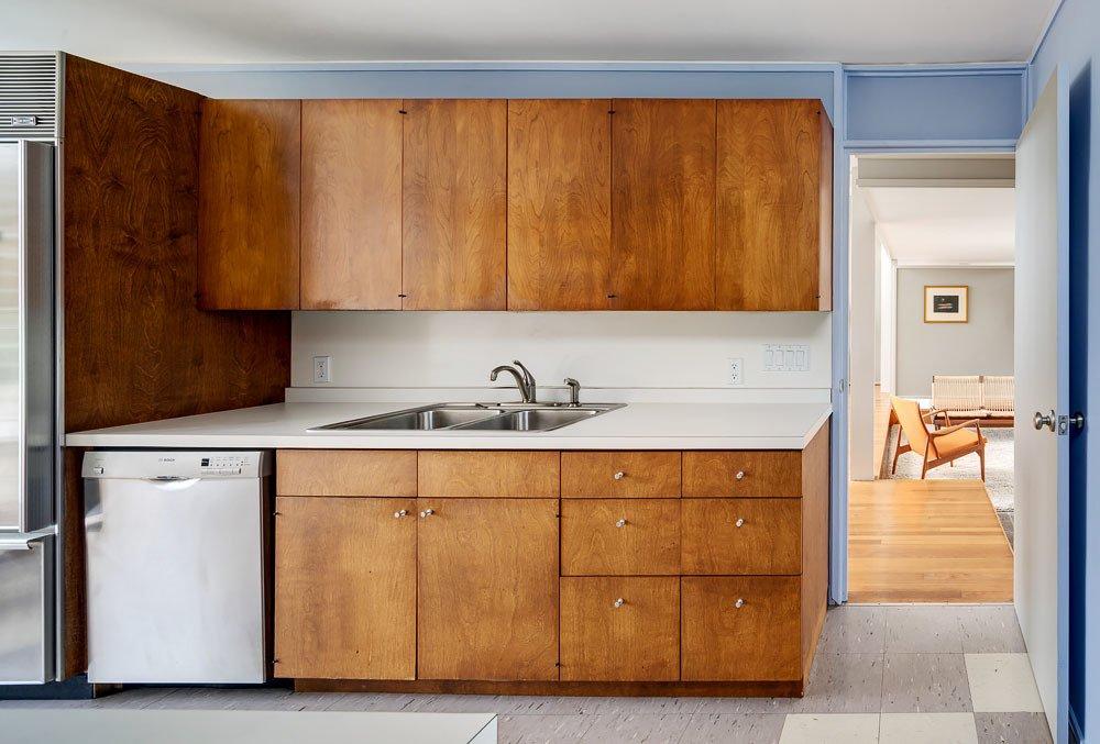 Kitchen, Laminate Counter, Recessed Lighting, Drop In Sink, Wine Cooler, Dishwasher, Linoleum Floor, and Wood Cabinet Umbrella House, kitchen  Umbrella House