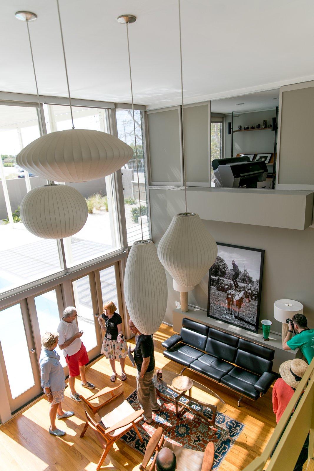 Living Room, Pendant Lighting, Chair, Medium Hardwood Floor, Sofa, Coffee Tables, and Lamps Umbrella House, living room  Umbrella House