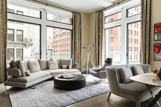 LIVING ROOM: Contemporary and warm with the use of textured fabrics and Italian furniture