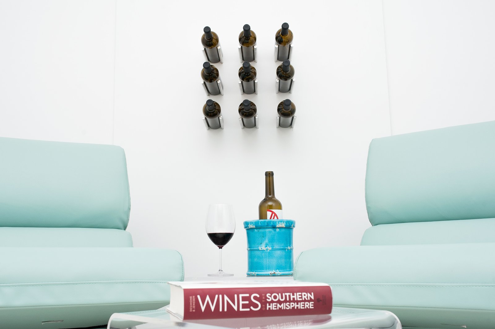 """Vino Rails take the traditional """"cork forward"""" wine storage design, and redefine it with contemporary style. These metal wine pegs attach direct to any wall surface, even drywall.   Vino Series Metal Wine Pegs"""