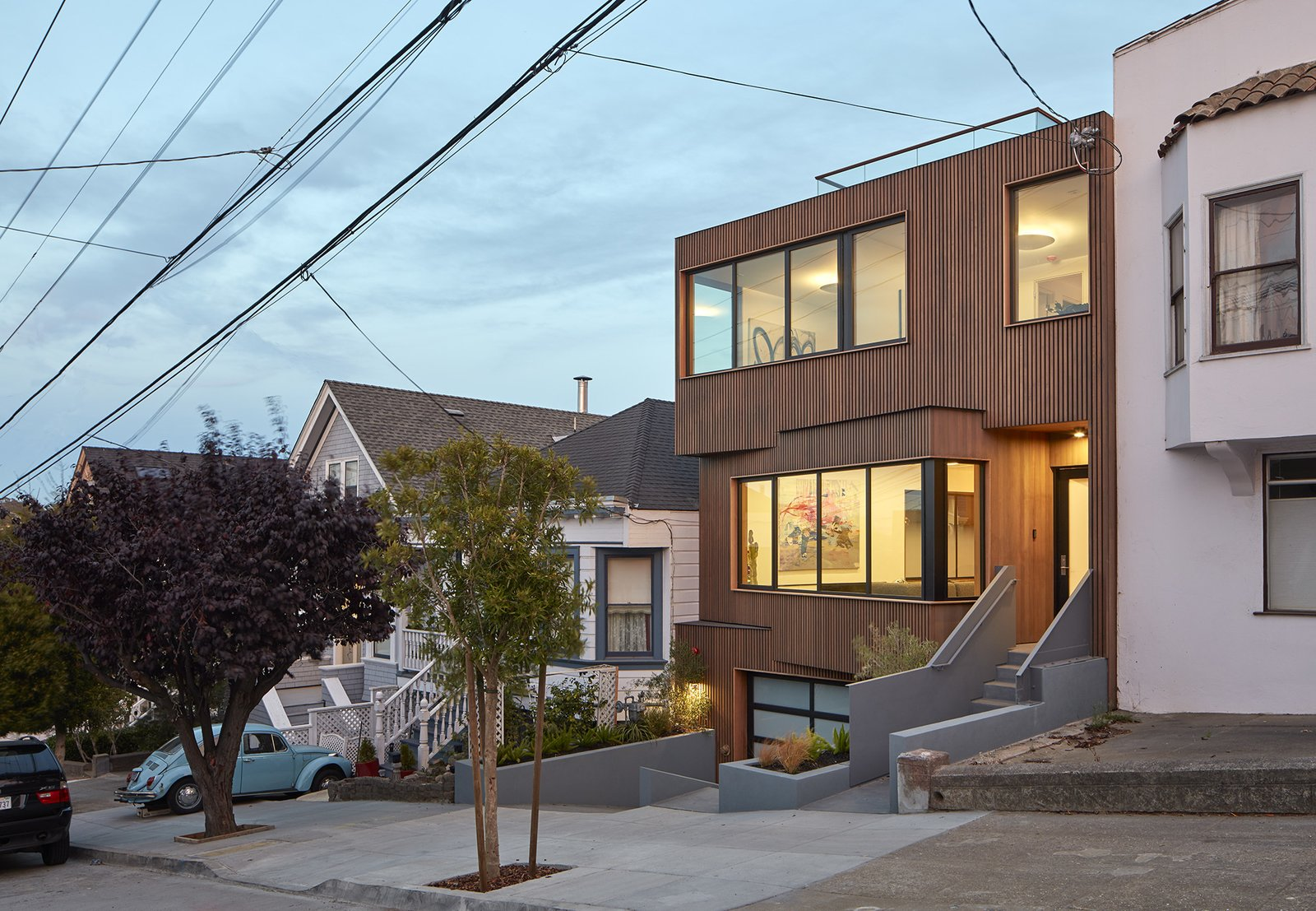 Exterior, Flat RoofLine, Wood Siding Material, and House Building Type View of house amongst neighbors along street.  Noe Valley House by IwamotoScott Architecture