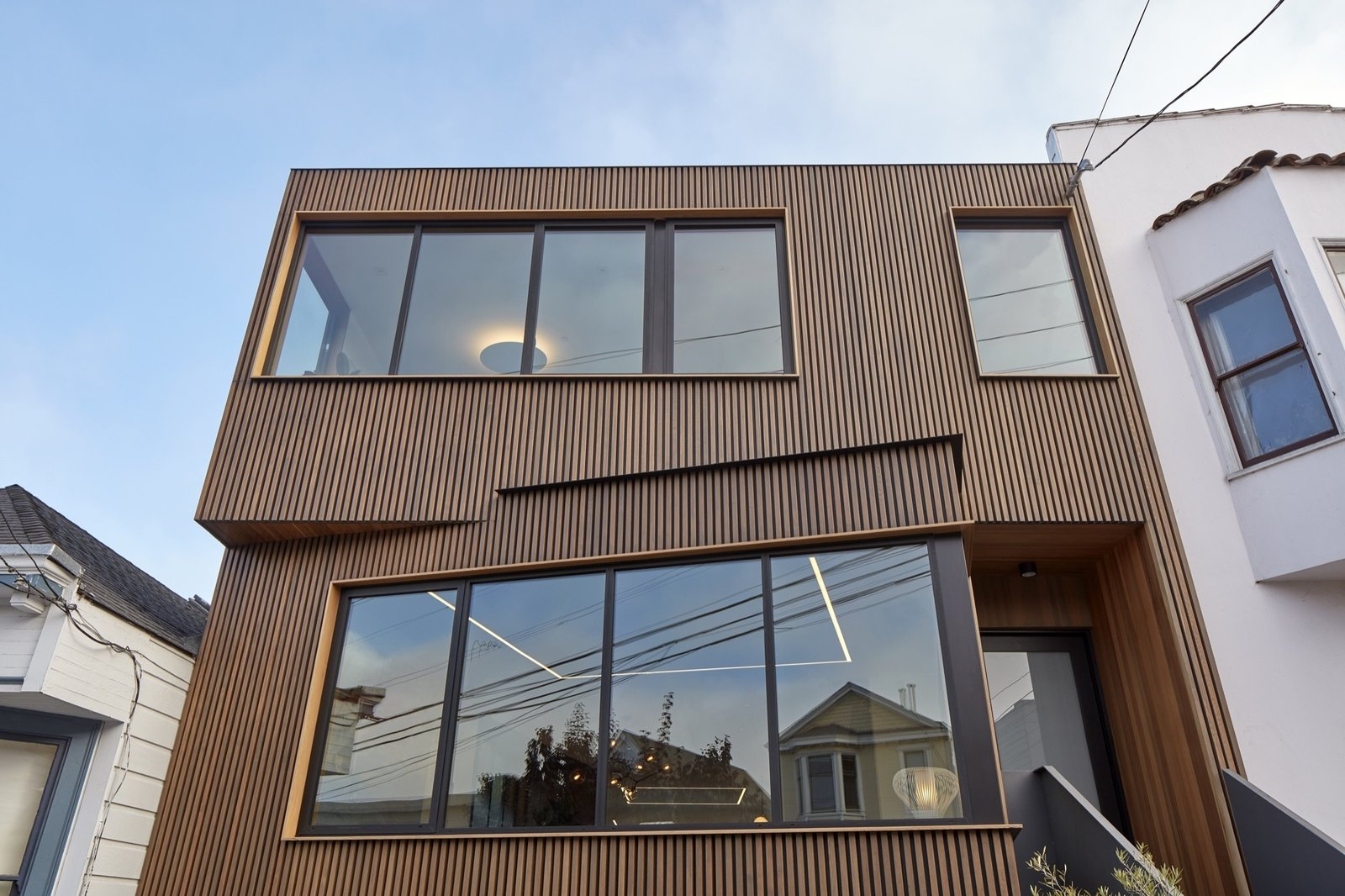 Windows, Casement Window Type, Picture Window Type, and Metal View looking up at facade from sidewalk.  Noe Valley House by IwamotoScott Architecture