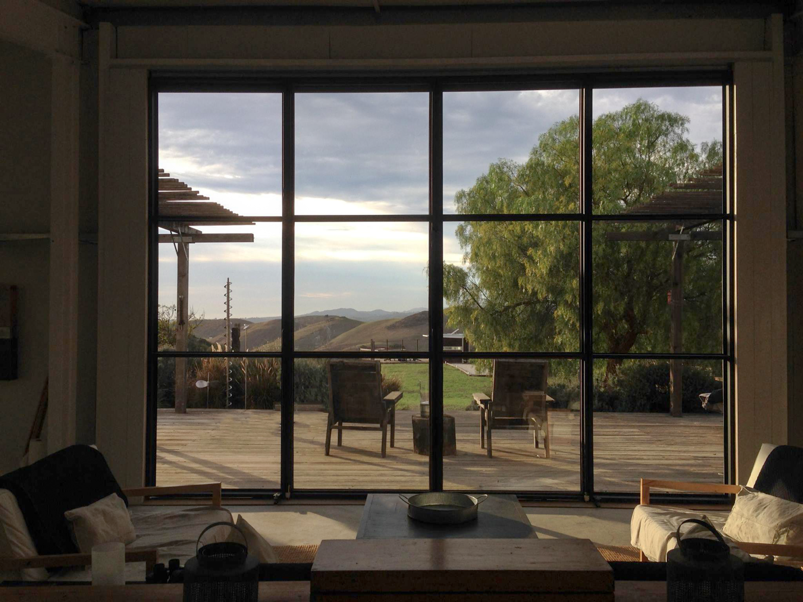 View from inside main barn  Barking Dog Ranch by kitHAUS