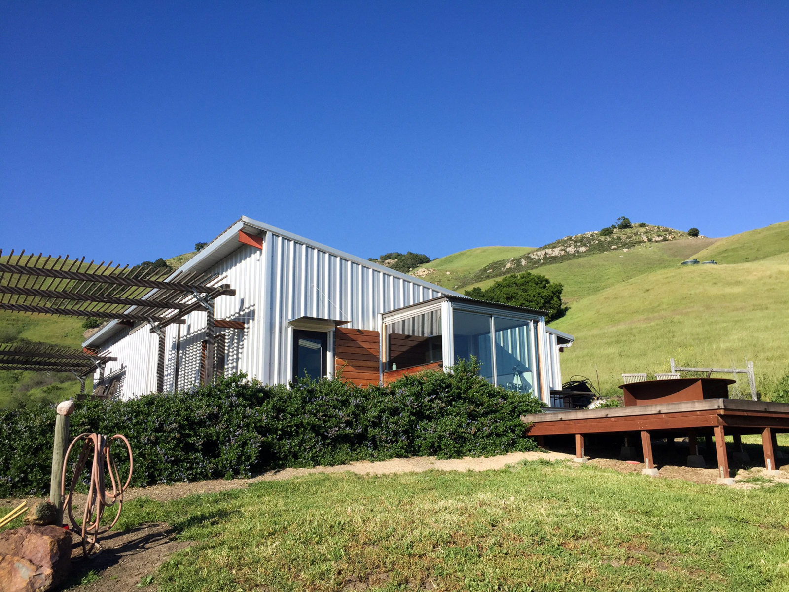 Main barn and side deck with fire pit  Barking Dog Ranch by kitHAUS