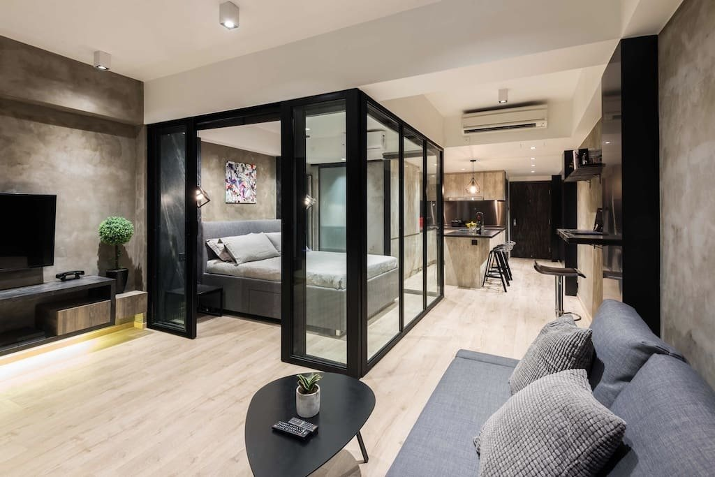 This stylish apartment in Wan Chai was designed with a glass-framed bedroom cubicle in the middle of the space. The sleek, open-concept kitchen is equipped with an oven, fridge, built-in washing machine, Nepresso machine, toaster, and powerful induction hobs.