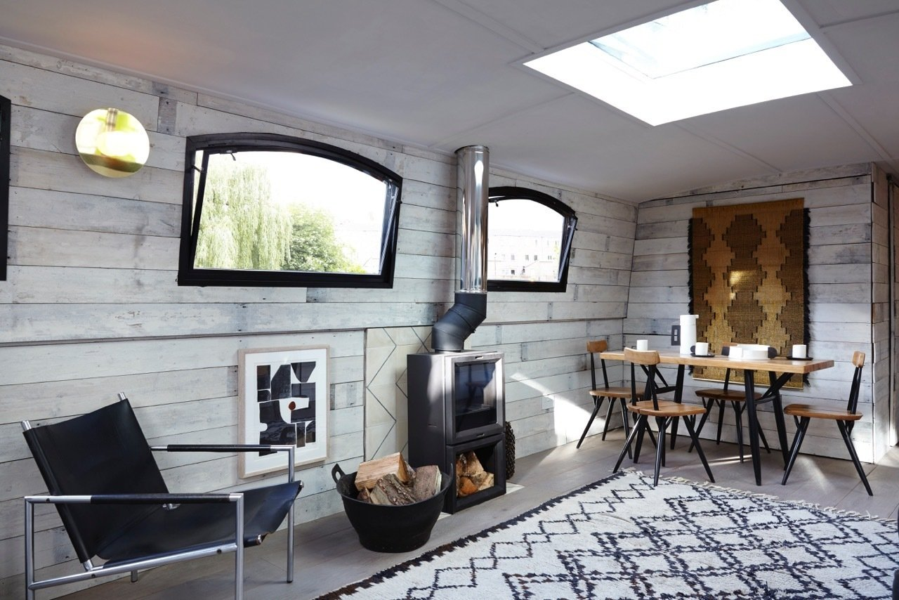 London boutique barge hotel brand Berts Barges offer the ultimate floating suites with simple yet sophisticated vintage Scandi interiors, wood burning stoves, underfloor heating, bathrooms with walk-in showers and a private roof terrace.  Photo 3 of 11 in Make Yourself at Home in One of These Small Spaces on Boats That You Can Rent