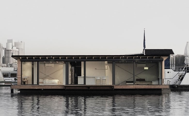 Moored in Lake Rummelsburg in Berlin, this 60 square meter houseboat has full height windows that open to views of the water and the city horizon. It had a large living area, open kitchen and fireplace and can comfortably accommodate two adults and two children.  Photo 7 of 11 in Make Yourself at Home in One of These Small Spaces on Boats That You Can Rent