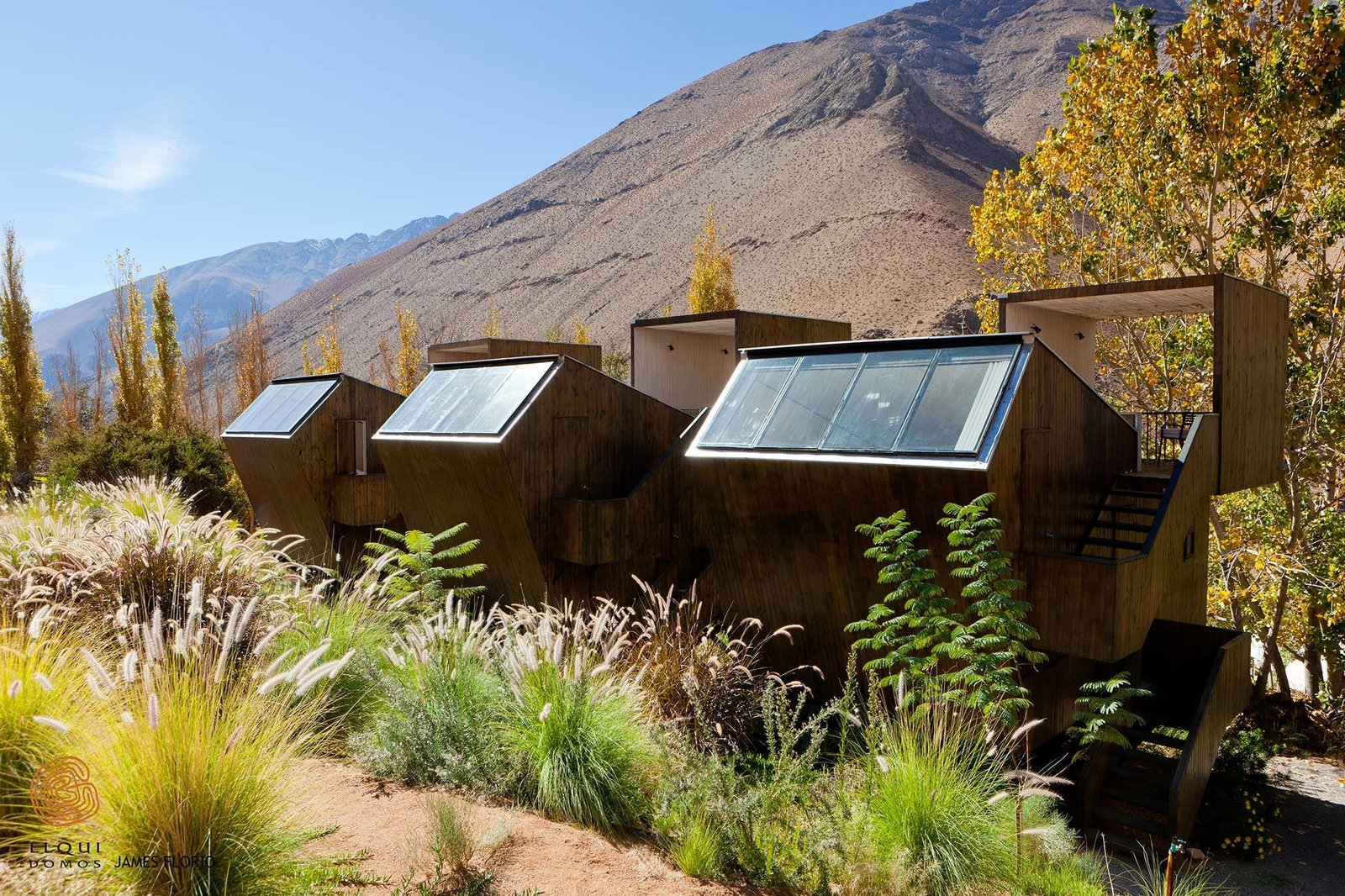 """Elqui Domos, a hotel in Chile's Elqui Valley offers """"observatory rooms"""" – three-level wooden cabins on the upper slope of the land that offer direct sightlines towards the dramatic scenery outdoors.  Photo 5 of 10 in Get Back to Basics by Staying at One of These Modern Cabins"""