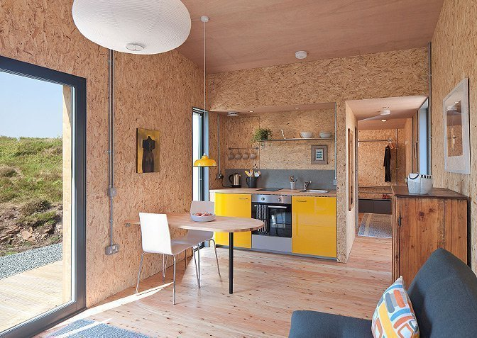 This compact, environmentally friendly modern studio cabin in the west coast of Scotland's Isle of Skye is designed by Rural Design Architects and perfect for a romantic escape in a remote site surrounded by natural beauty.  Photo 8 of 10 in Get Back to Basics by Staying at One of These Modern Cabins