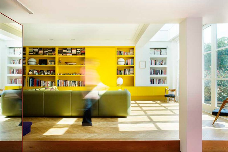 Storage, Sofa, Chair, Shelves, Living Room, Table Lighting, Lamps, and Light Hardwood Floor London studio AMA uses bold Bauhaus colors to invigorate Chevron House, a five-bedroom home in a brick Edwardian building in West London.  Photo 6 of 13 in Bright Bauhaus Colors Fill This Brick Edwardian House in London