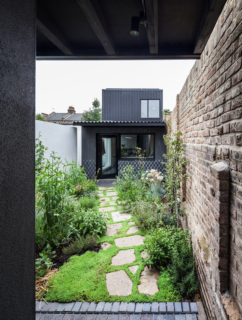 This two-bedroom house within the walls of an infill site in East London relies of a series of courtyards as its main source of sunlight.  Photo 8 of 10 in 10 Homes With Large, Well-Ventilated Courtyards