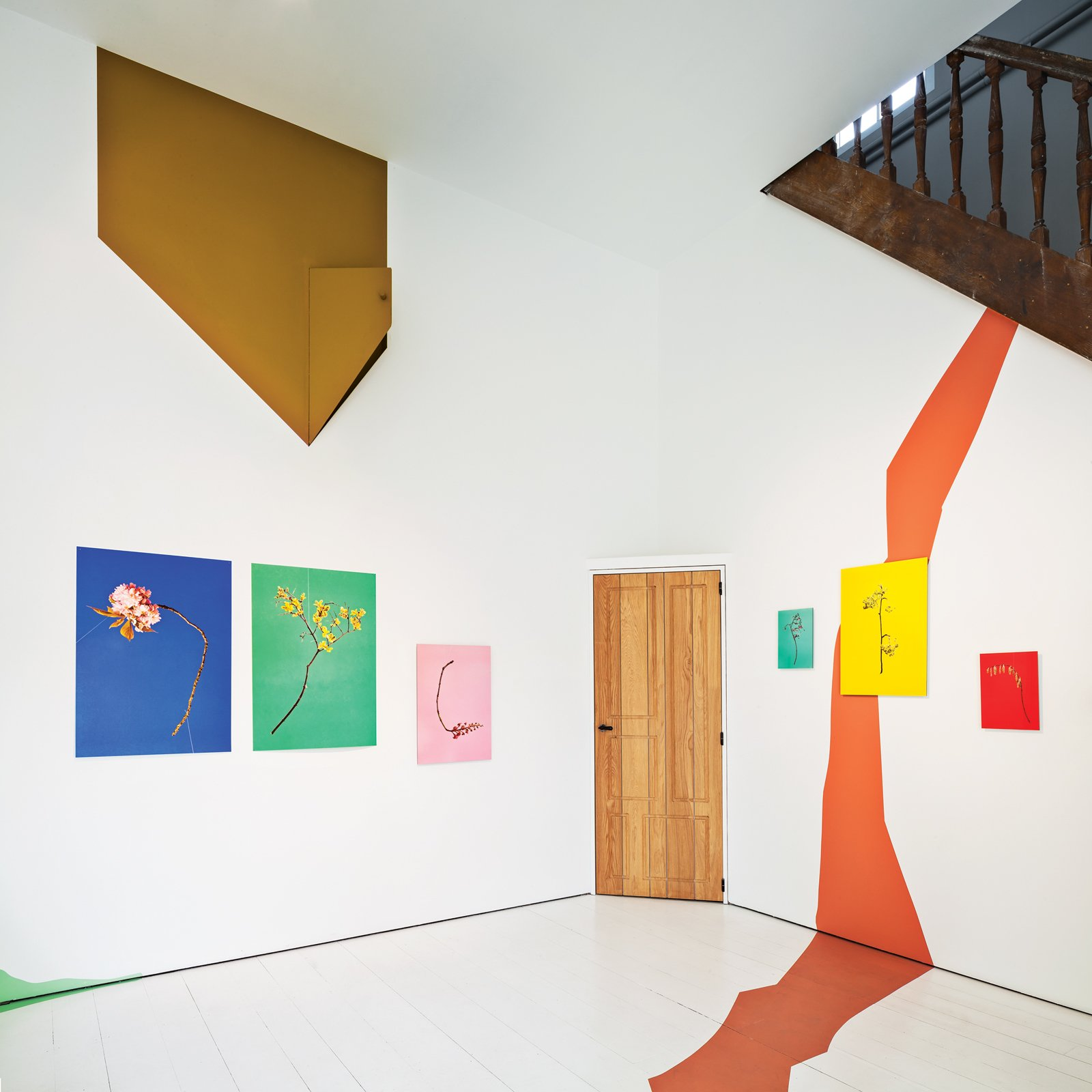 Works by Raw Color adorn the walls of the upstairs gallery room of Belgium architect and artist Veerle Wenes.  Photo 3 of 10 in 9 Small Spaces With  Color
