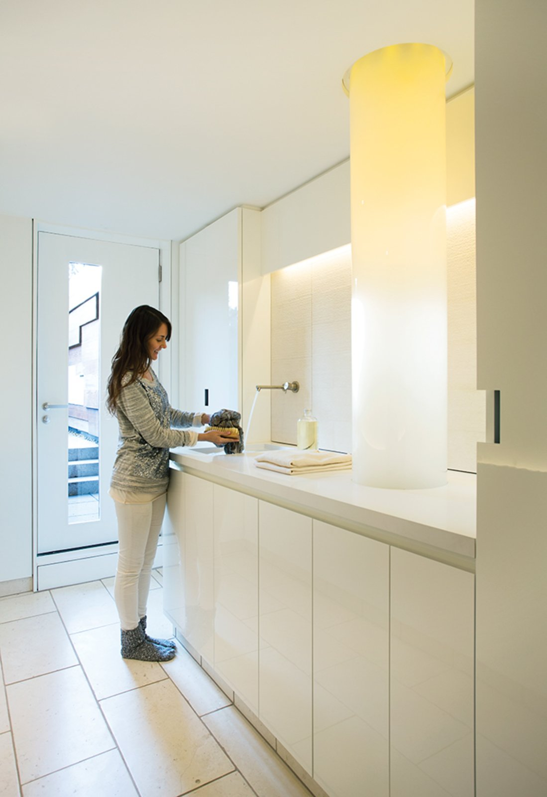 Bath Room, Accent Lighting, and Undermount Sink In Boston's South End, architect Anne Barrett of 30E Design has revamped a laundry in a traditional brownstone. Illuminated by a bundle of fiber-optic cables—this laundry room is more of an art installation than a hub for domestic chores.  Photo 2 of 8 in 7 Modern Laundry Rooms