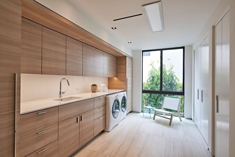 Bath Room, Undermount Sink, Recessed Lighting, Ceiling Lighting, and Light Hardwood Floor Designed by Miami firm, One D+B Architecture, laundry room has plenty of natural light, tall wardrobes and clean and simple warm wood everywhere.  Photo 3 of 8 in 7 Modern Laundry Rooms
