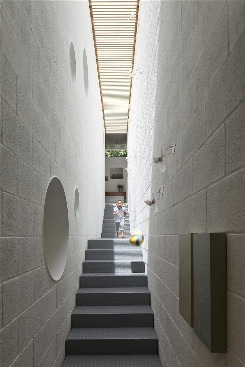 Windows, Skylight Window Type, and Wood In the home of Israeli architect Pitsou Kedem is an elongated skylight that runs along the entire length of a stairwell, flooding the interiors with sunshine.  Photo 2 of 10 in 10 Light-Filled Homes With Interesting Skylights