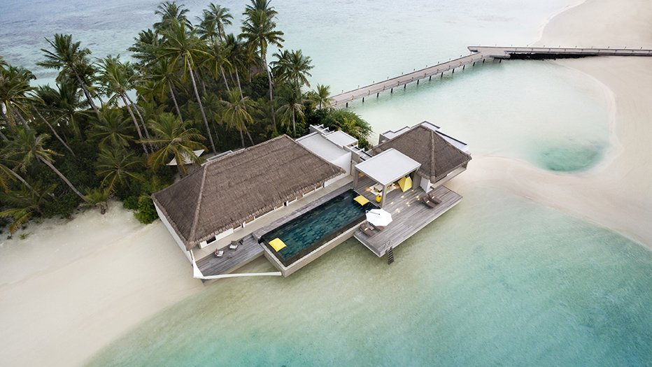 Exterior and Beach House Building Type This resort offers two types of overwater villas – the Water Villa which many terraces overhanging above the sea, and the Garden Water Villa, which dips into the lagoon on one side while facing a lush tropical garden on the other.  Photo 5 of 9 in 9 Modern Maldivian Resorts With Spectacular Overwater Villas
