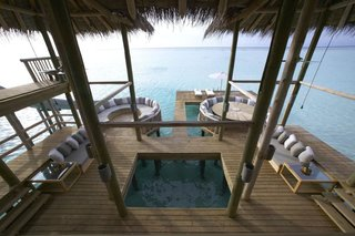 This resort has 45 overwater villas, including the Crusoe Residences with its own rooftop sundeck and private water hammock, and the 5,577 square foot Private Reserve, which has a sundeck with an infinity pool, a spa, sauna, steam room and gym, and a bathtub built over coral gardens.