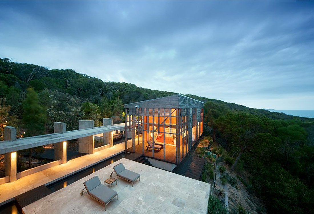 Nestled amidst Australian bushland, and set high above the Pacific Ocean, this house by award-winning Australian architect James Grose of Bligh Voller Nield was built with minimal impact on its natural environment.  Photo 1 of 10 in 10 Cliffside Destinations That Will Make You Feel on Top of the World
