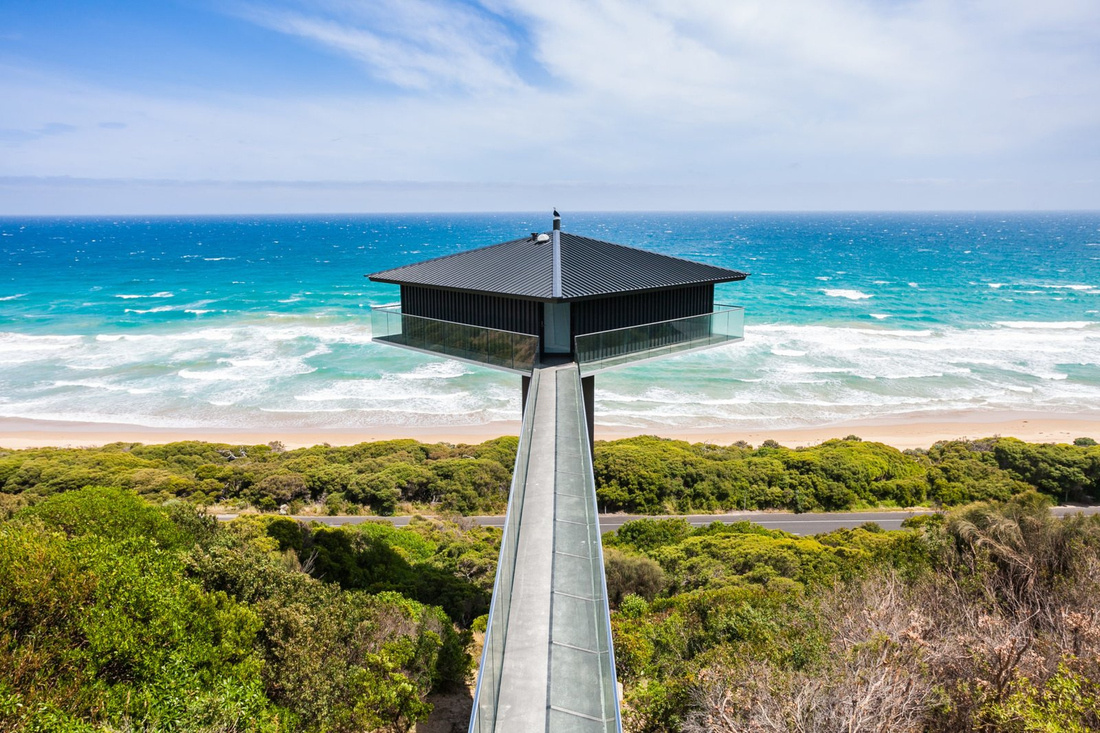 Rumored to be one of the most photographer homes on The Great Ocean Road, this house is suspended 40 meters above Fairhaven Beach. Designed F2 Architecture, the house balances atop a concrete platform supported by a 13-meter high plylon, accessible via a narrow bridge.  Photo 3 of 10 in 10 Cliffside Destinations That Will Make You Feel on Top of the World