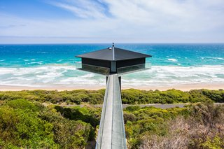 Rumored to be one of the most photographed homes on the Great Ocean Road, this house is suspended 131 feet above Fairhaven Beach. Designed by F2 Architecture, the house balances atop a concrete platform supported by a 42-foot-high plylon and is accessible via a narrow bridge.