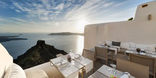 At this modern Cycladic boutique hotel in the village of Imerovigli, you can enjoy breathtaking views of Santorini's majestic caldera from the pool, your bedroom, or the resort's fine dining restaurant.